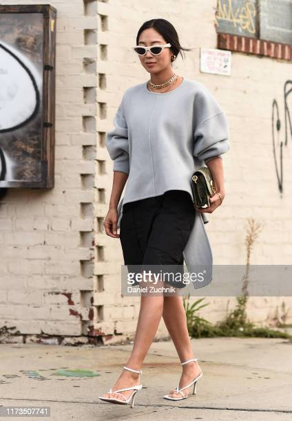 Aimee Song is seen wearing a gray Phillip Lim sweater black skirt and white sunglasses outside the Phillip Lim show during New York Fashion Week...