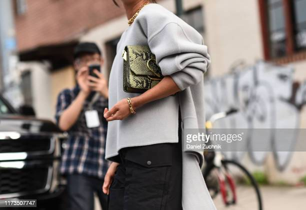 Aimee Song is seen wearing a gray Phillip Lim sweater, black skirt outside the Phillip Lim show during New York Fashion Week S/S20 on September 09,...