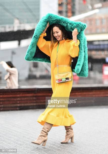 Aimee Song is seen wearing a Tibi dress outside the Tibi show during New York Fashion Week Women's A/W 2018 on February 11 2018 in New York City