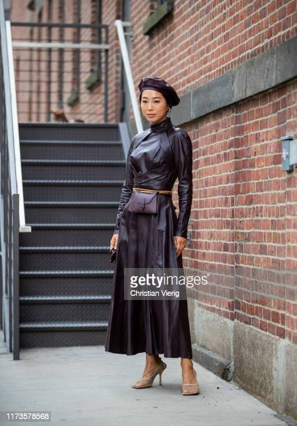 Aimee Song is seen wearing brown leather dress, beret outside Zimmermann during New York Fashion Week September 2019 on September 09, 2019 in New...