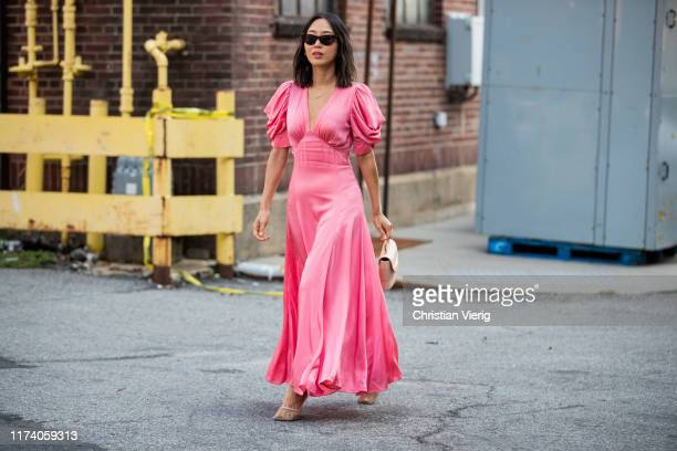 Aimee Song is seen wearing pink dress outside Michael Kors during New York Fashion Week September 2019 on September 11 2019 in New York City
