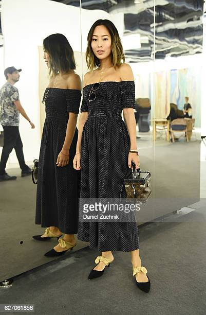 Aimee Song is seen wearing The Row THE GREAT and Louis Vuitton at the Art Basel Miami Beach Vernissage at the Miami Beach Convention Center on...