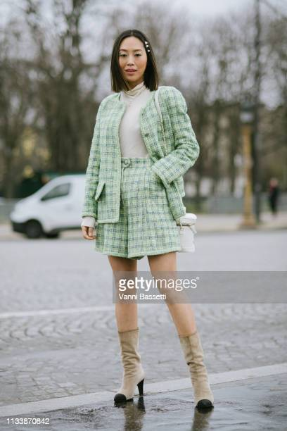 Aimee Song poses wearing Chanel after the Chanel show at the Grand Palais during Paris Fashion Week Womenswear Fall Winter 2019/2020 on March 05 2019...