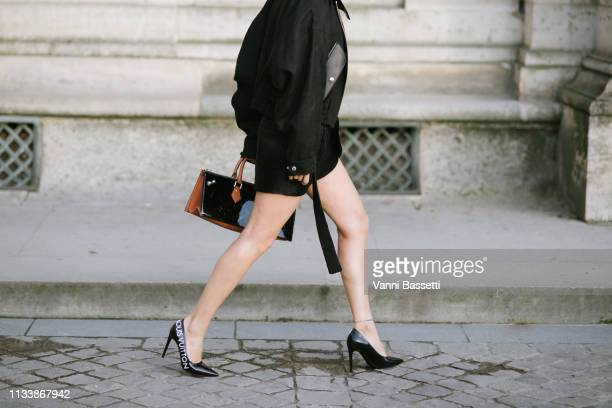 Aimee Song poses wearing Louis Vuitton after the Louis Vuitton show at the Carrousel du Louvre during Paris Fashion Week Womenswear Fall Winter...