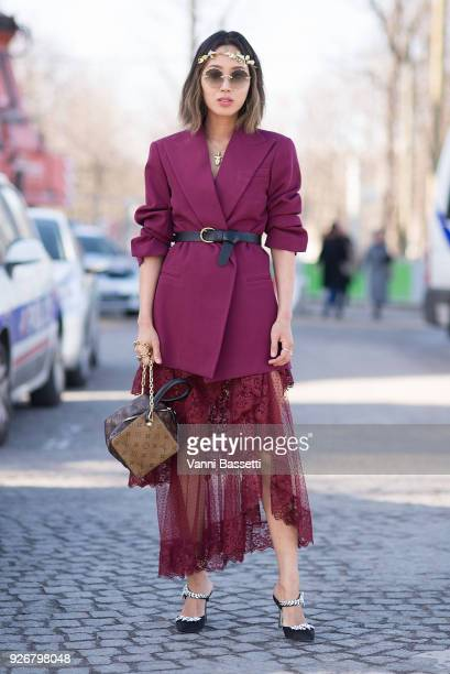 Aimee Song poses with a Louis Vuitton bag after the Elie Saab show at the Grand Palais during Paris Fashion week Womenswear FW 18/19 on March 3 2018...