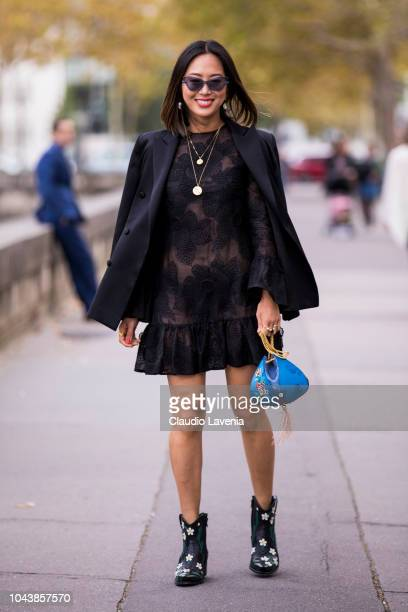 Aimee Song wearing a black lace mini dress black blazer black printed boots and blue mini bag is seen before the Valentino show on September 30 2018...