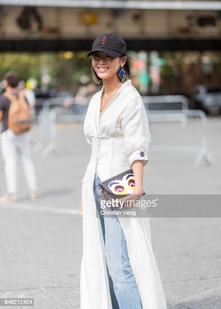 Aimee Song wearing a cap seen in the streets of Manhattan outside Coach during New York Fashion Week on September 12 2017 in New York City
