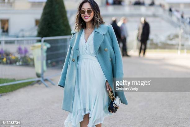 Aimee Song wearing a coat and dress Chloe bag outside Chloe on March 2 2017 in Paris France