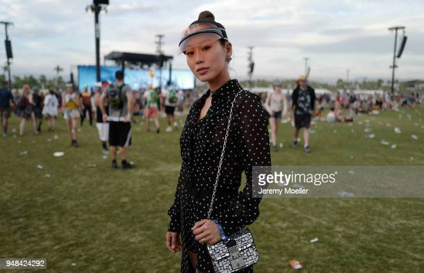 Aimee Song wearing a complete Dior look during day 3 of the 2018 Coachella Valley Music Arts Festival Weekend 1 on April 15 2018 in Indio California