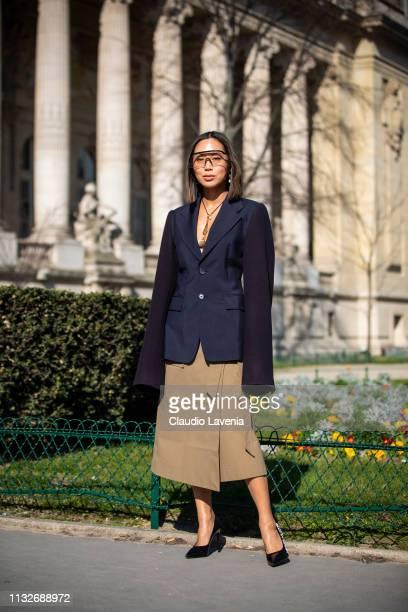 Aimee Song wearing a dark blue blazer beige midi skirt and black Louis Vuitton heels is seen outside Maison Margiela on Day 3 Paris Fashion Week...