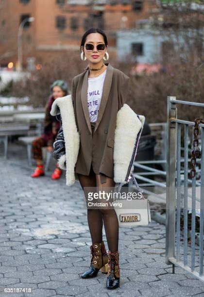 Aimee Song wearing a Dior bag blazer outside 31 Phillip Lim on February 13 2017 in New York City