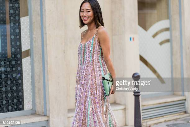 Aimee Song wearing a dress outside Valentino during Paris Fashion Week - Haute Couture Fall/Winter 2017-2018 : Day Four on July 5, 2017 in Paris,...