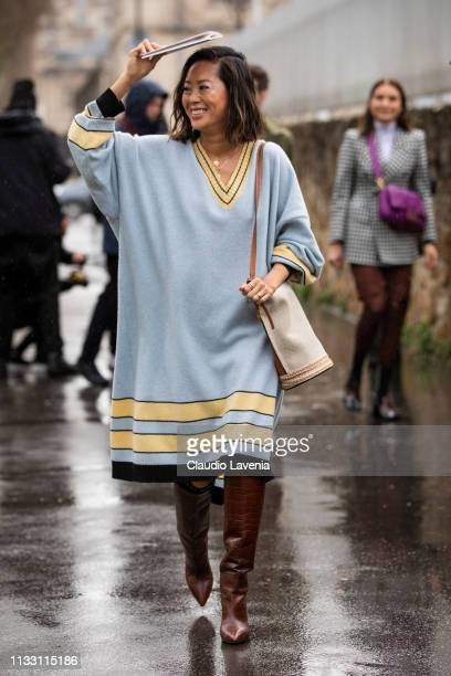 Aimee Song wearing a long light blue sweater dress burgundy boots and cream bag is seen outside Loewe on Day 5 Paris Fashion Week Autumn/Winter...