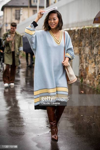 Aimee Song, wearing a long light blue sweater dress, burgundy boots and cream bag, is seen outside Loewe on Day 5 Paris Fashion Week Autumn/Winter...