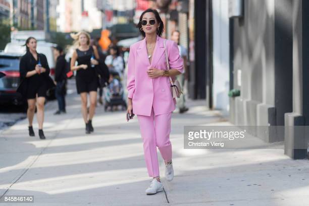 Aimee Song wearing a pink suit seen in the streets of Manhattan outside Phillip Lim during New York Fashion Week on September 11 2017 in New York City