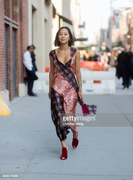 Aimee Song wearing a silk dress seen in the streets of Manhattan outside Diane von Furstenberg during New York Fashion Week on September 10 2017 in...