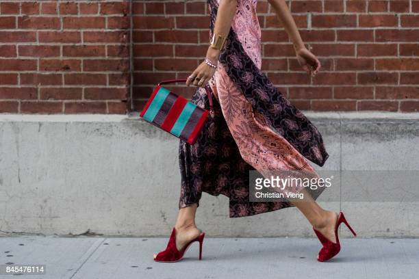 Aimee Song wearing a silk dress seen in the streets of Manhattan outside Diane von Furstenberg during New York Fashion Week on September 10, 2017 in...