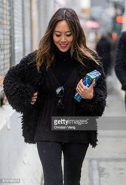 Aimee Song wearing a vlack fur jacket and black wide pants seen outside Jeremy Scott during New York Fashion Week Women's Fall/Winter 2016 on...