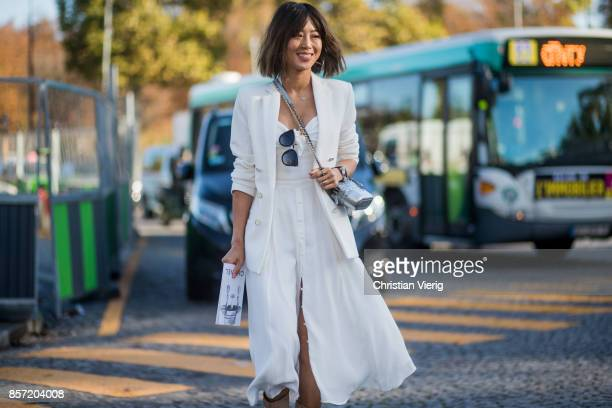 Aimee Song wearing a white dress white blazer jacket seen outside Chanel during Paris Fashion Week Spring/Summer 2018 on October 3 2017 in Paris...