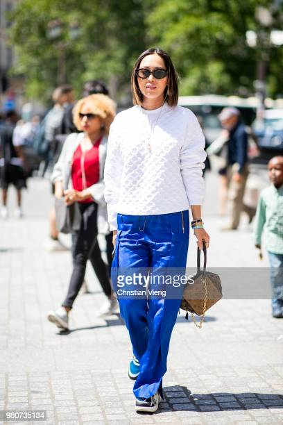 Aimee Song wearing blue pants white jumper is seen outside Louis Vuitton on day three of Paris Fashion Week Menswear SS19 on June 21 2018 in Paris...