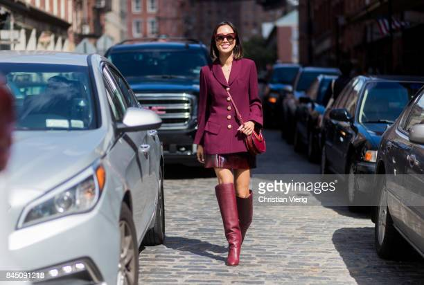 Aimee Song wearing bordeaux blazer jacket skirt boots seen in the streets of Manhattan outside Tibi during New York Fashion Week on September 9 2017...
