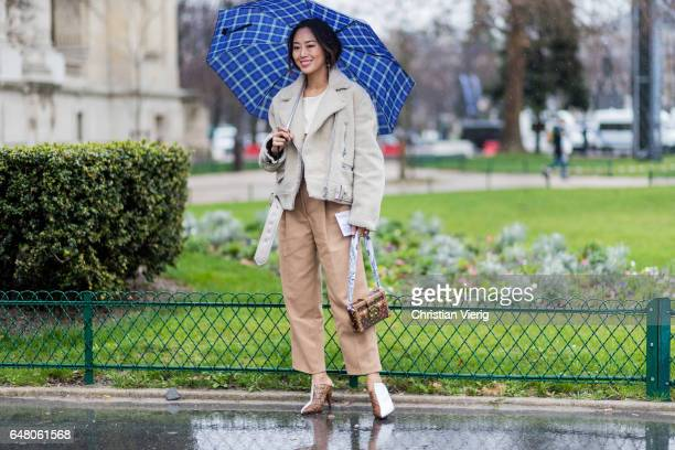 Aimee Song wearing brown trousers white jacket outside Elie Saab on March 4 2017 in Paris France