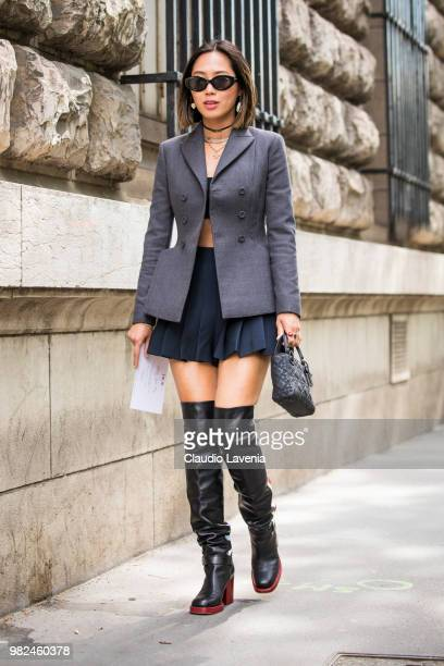 Aimee Song, wearing grey jacket, black skirt and Dior black bag, is seen in the streets of Paris before the Dior Homme show, during Paris Men's...