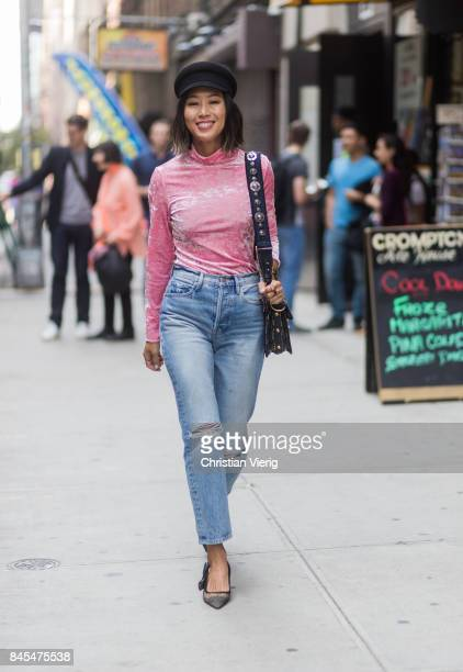Aimee Song wearing pink longshirt flat cap seen in the streets of Manhattan outside Sies Marjan during New York Fashion Week on September 10 2017 in...
