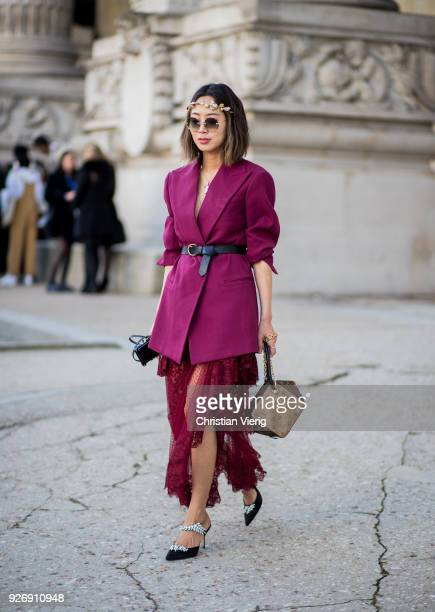 Aimee Song wearing sheer skirt blazer with belt Louis Vuitton bag is seen outside Elie Saab during Paris Fashion Week Womenswear Fall/Winter...