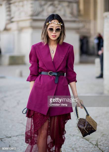 Aimee Song wearing sheer skirt blazer with belt Louis Vuitton bag is seen outside Elie Saab during Paris Fashion Week Womenswear Fall/Winter...