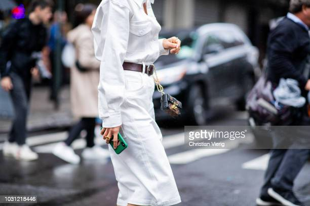 Aimee Song wearing white dress with belt Louis Vuitton bag is seen outside 31 Phillip Lim during New York Fashion Week Spring/Summer 2019 on...