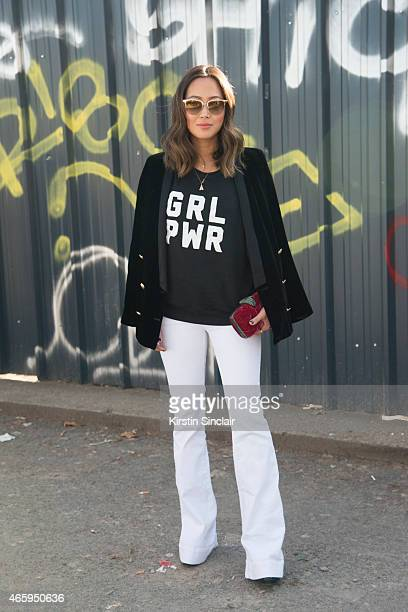 Aimee Song wears a 2 cent t shirt J Brand jeans and Oliver Peoples sunglasses on day 6 of Paris Collections Women on March 08 2015 in Paris France