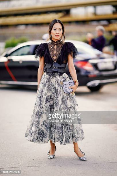Aimee Song wears a black faux fur lace mesh top a printed skirt outside Dior during Paris Fashion Week Womenswear Spring/Summer 2019 on September 24...