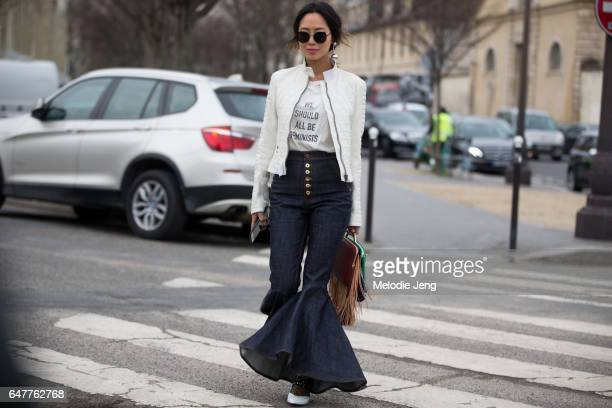 Aimee Song wears a Dior 'We Should All Be Feminists' tshirt outside the Loewe show on March 3 2017 in Paris France