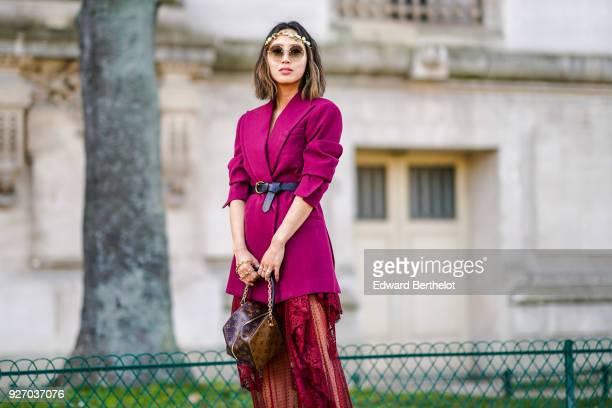 Aimee Song wears a purple blazer jacket a red lace mesh dress shoes a Vuitton bag during Paris Fashion Week Womenswear Fall/Winter 2018/2019 on March...