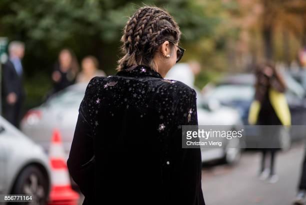 Aimee Song with braids hair wearing denim jeans black coat seen outside Sacai during Paris Fashion Week Spring/Summer 2018 on October 2 2017 in Paris...