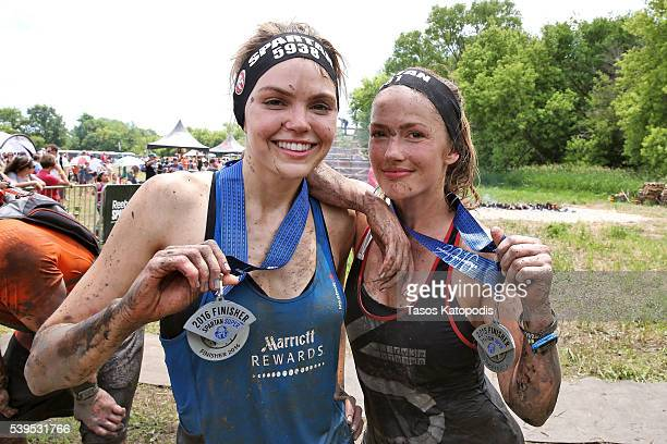 Aimee Teegarden and Minka Kelly after completing the Spartan Super Race as Marriott Rewards reunites Taylor Kitsch, Minka Kelly, Zach Gilford and...