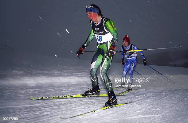 Aimee Watson of Australia and SeulGi Nam of Korea competes in the FIS women's 5km Cross Country Skiing during day four of the Winter Games NZ at the...