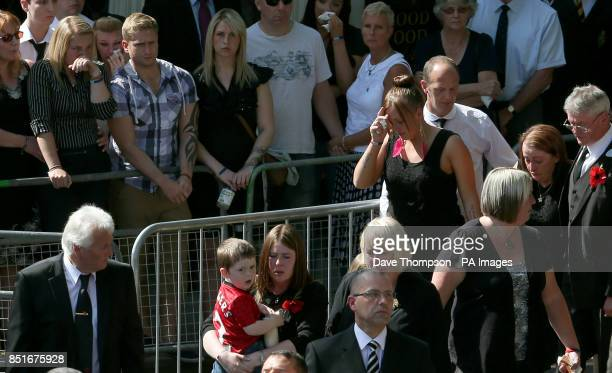 Aimee West fiancee of Fusilier Lee Rigby watches as wife Rebecca Rigby carrying son Jack follows the coffin as it arrives at Bury Parish church in...