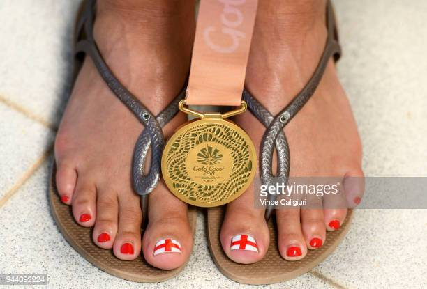 Aimee Willmott of England poses her Gold medal on her feet at team England Headquarters in Main Beach on day six of the Gold Coast 2018 Commonwealth...