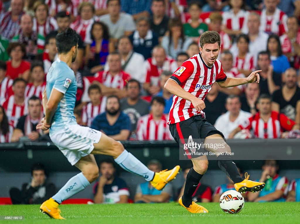 Aimeric Laporteof Athletic Club duels for the ball with Eneko Boveda of SD Eibar during the La Liga match between Athletic Club and SD Eibar at San Mames Stadium on September 27, 2014 in Bilbao, Spain.