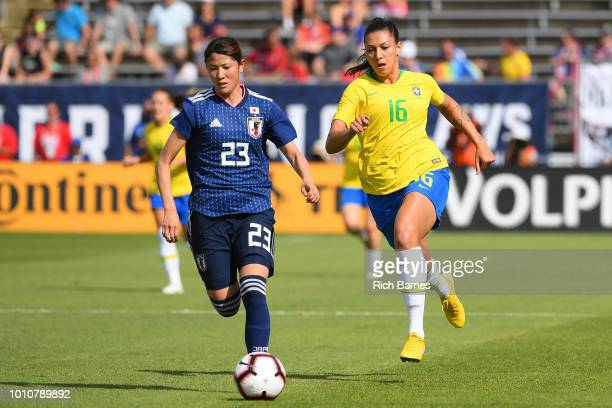 Aimi Kunitake of Japan controls the ball as Beatriz of Brazil defends during the first half of a Tournament of Nations game played at Pratt Whitney...
