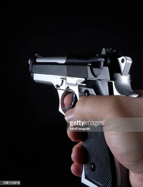 aiming 9mm handgun