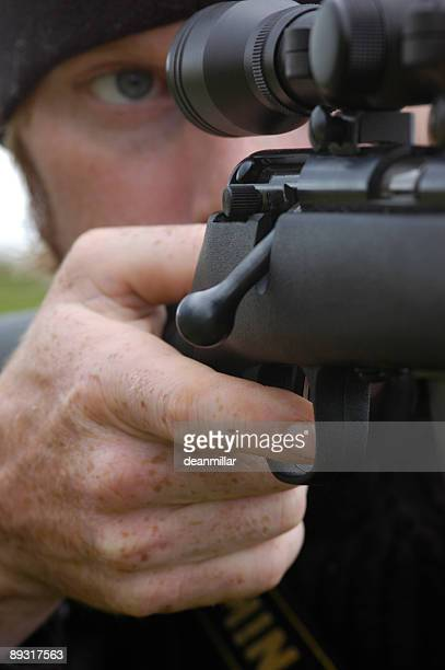 aiming through the scope - animal finger stock photos and pictures