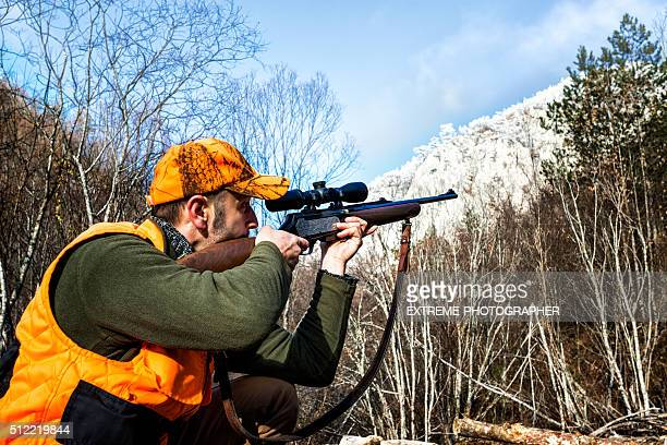 Aiming with rifle in the wilderness