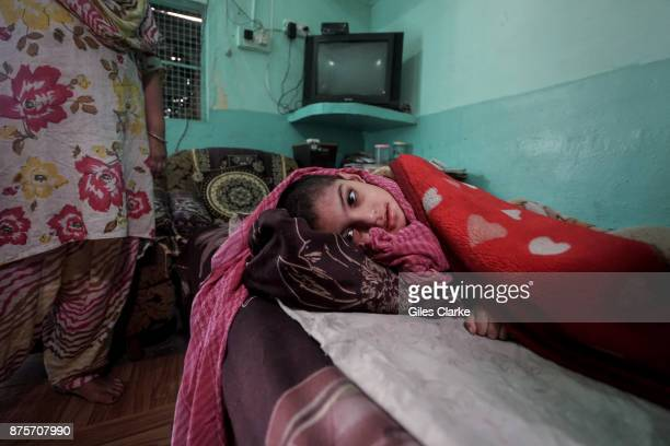 Aina 5 years old at home in the Ariy Nagar neighborhood Aina was born to parents contaminated by a carcinogenic and mutagenic water supply This year...