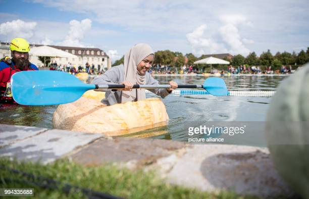 Aina Lohnhub paddles in a pumpkin boat during the first day of the pumpkin boat race in the gardens of the Bluehende Barock in Ludwigsburg Germany 16...