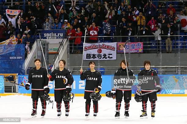 Aina Takeuchi, Ami Nakamura, Yurie Adachi, Tomoko Sakagami and Yuka Hirano of Japan acknowledge the fans after the Women's Ice Hockey Preliminary...
