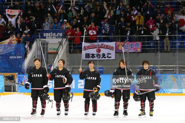 Aina Takeuchi, Tomoe Yamane, Yurie Adachi, Tomoko Sakagami and Yuka Hirano of Japan acknowledge the fans after the Women's Ice Hockey Preliminary...