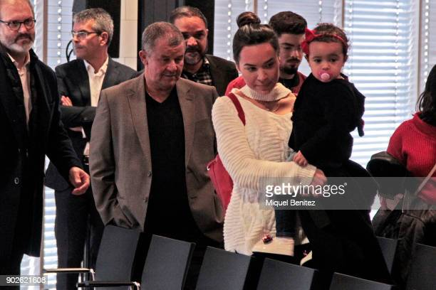 Aine Coutinho carries her daughter Maria Coutinho as she attends presentation of her husband Philippe Coutinho as Barcelona's new signing with the...